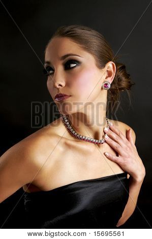 Woman in an elegant evening gown and diamonds