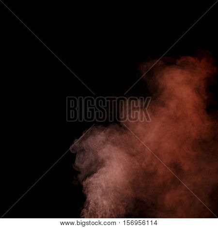 Abstract red water vapor on a black background. Texture. Design elements. Abstract art. Steam the humidifier. Macro shot.