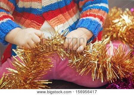 Kid with frippery preparing for Christmas. Horizontal photo