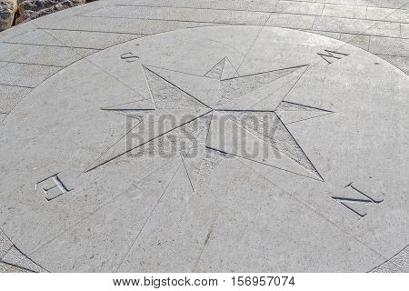 Compass engraved on the stone pier, Tucepi town.