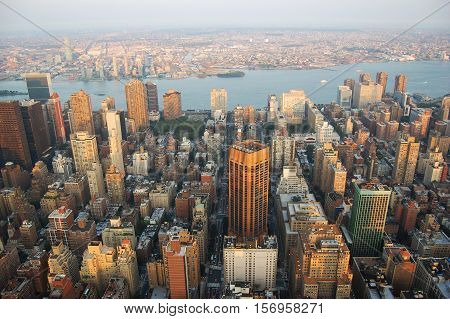 Manhattan Skyline aerial view east and Brooklyn, viewed from Empire State Building, New York City, USA.