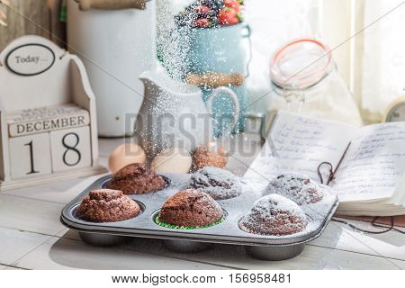 Decorating Tasty Cupcakes With Caster Sugar On Old White Table