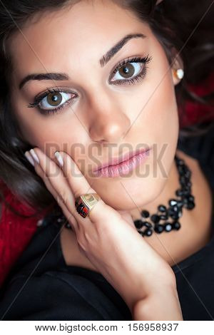 Beautiful Woman Face, Posing With Hand, Looking Straight In The Eyes, Close Up