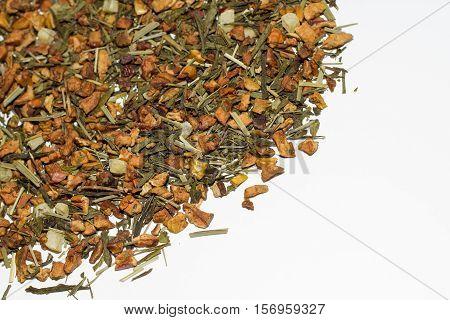 Loose leaf apple tea on white background.
