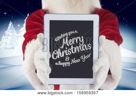 Santa claus showing digital tablet with christmas greeting against digitally generated background