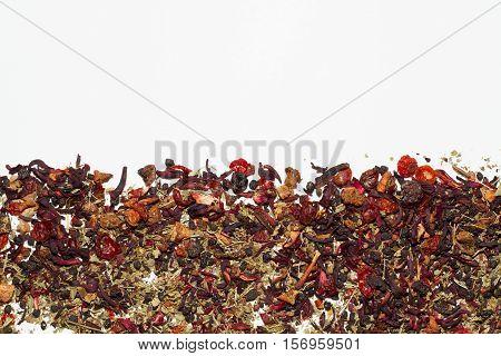 Loose leaf fruit tea on simple background.