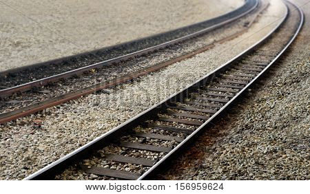 Railway train tracks perspective view in close up