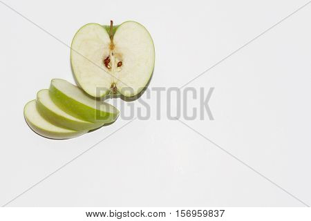 Green apple sliced on a white background.