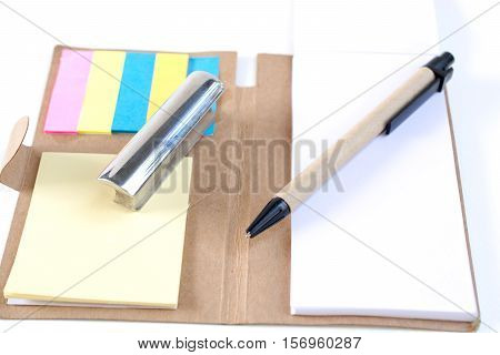 Pencils pens paperweights put on your desk on a white background.