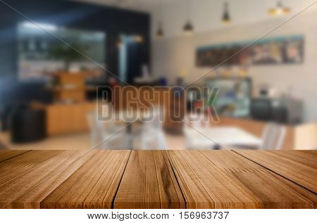 Selected Focus Empty Brown Wooden Table And Coffee Shop Or Restuarant Blur Background With Bokeh Ima