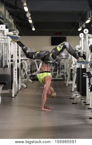 Gymnastic Fit Girl Is Standing On Hands