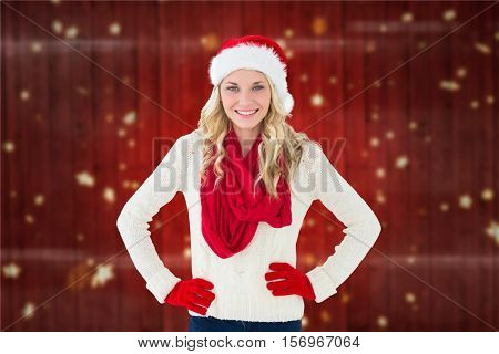 Portrait of smiling woman in santa hat against digitally generated background