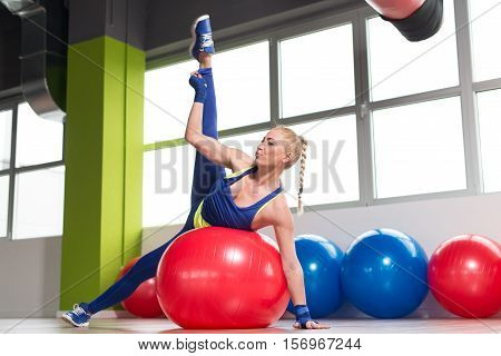 Healthy Woman Stretches On Ball