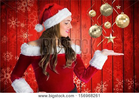 Beautiful woman in santa costume pretending to hold during christmas time