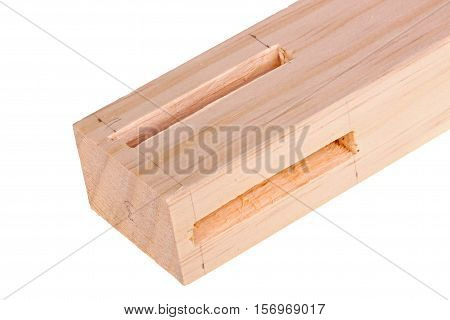 Close-up of the end of a pine board with two freshly cut woodworking mortises isolated against a white background