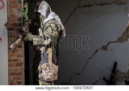 Sniper aim target ghillie suit inside building