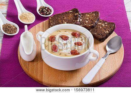 Beer And Cheddar Cream Soup With Kielbasa Sausage