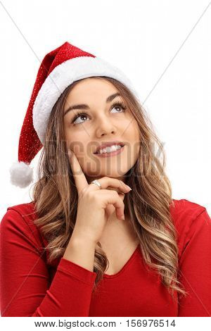 Young woman with a Christmas hat making a wish isolated on white background