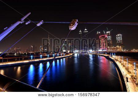 Dubai Skyline at night from new Dubai Canal, U.A.E