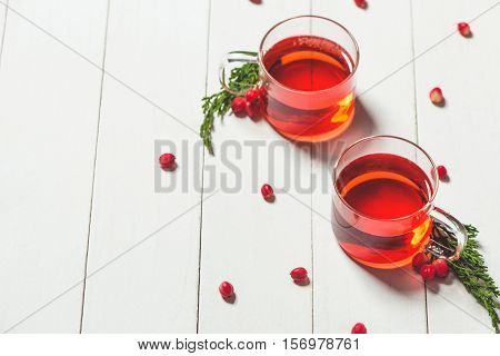 Glass cup of tea on wood table