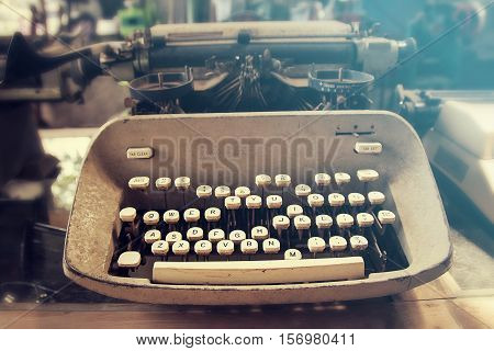 A antique Typewriter machine closeup, vintage tone