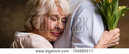 Older Woman Snuggles Up To Partner