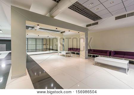 Modern Corridor With White Pillars