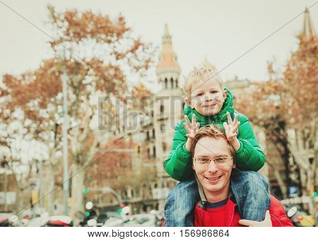 father and little son travel on Placa de Catalunya, Catalonia Square, Barcelona, Spain