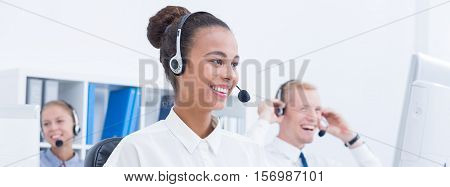 Smiled and happy telemarketers in the office interior