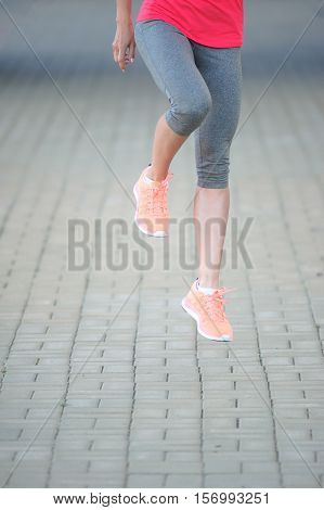 fitness jogger legs running at park. Woman fitness jogging workout wellness concept.