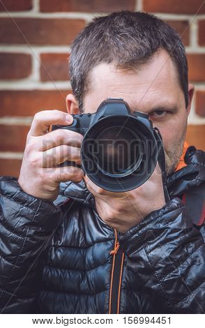 Portrait of a professional photographer with a camera