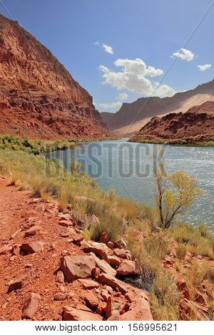 Red rocks and blue river. Bend of the Colorado River among the rocky mountains of red sandstone
