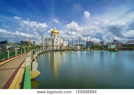 The floating & famous Sultan Omar Ali Saifuddien Mosque in Brunei Darusallam with blue sky background & reflection from the calm lake.