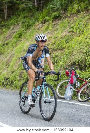 Col du Tourmalet France - July 24 2014: The Italian cyclist Mateo Trentin (Omega Pharma-Quick Step) climbig the road to Col du Tourmalet in Pyerenees mountains during the stage 18 of Le Tour de France 2014.