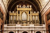 Big organ in Esztergom basilica Hungary. Interior of religious architecture. Place of worship. Cultural heritage. Retro photo filter. Church musical instrument. poster