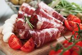 Slices of capocollo or capicola, italian cured and aged pork meat poster