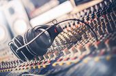 Mixer and Professional Headphones in the Recording Studio. Sound Mixing Desk. Sound Mastering For Radio and TV Broadcast. poster