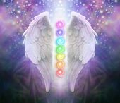 Angel Wings Chakras Darkness and Light - A pair of Angel wings with the seven chakras between with dark blue black and purple behind, a shaft of light and sparkles poster