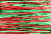 Background - red and green paper raffia strips situated in parallel lines poster