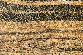 big colorful stone in strips as background