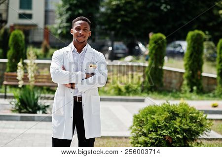 African American Doctor Male At Lab Coat With Stethoscope Outdoor.
