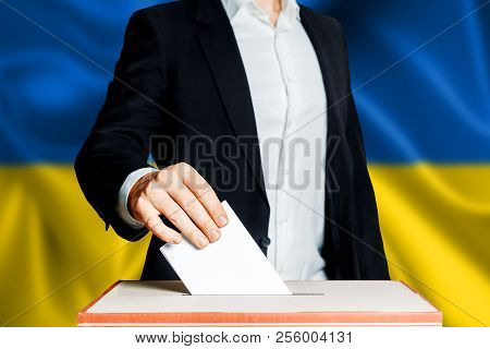 Elections in Ukraine, political struggle. Democracy, freedom and independence concept. Citizen Voter Putting Ballot In to Voting box poster