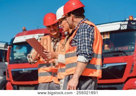 Driver and booker of heavy transport cargo company talking