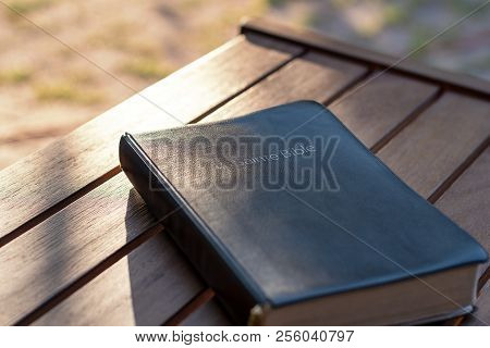 Christian Worship And Praise. The Bible On A Chair In The Morning Light. Text : Holy Bible (in Frenc