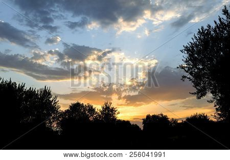 Sunset In The Countryside With A Beautiful Cloudy Sky