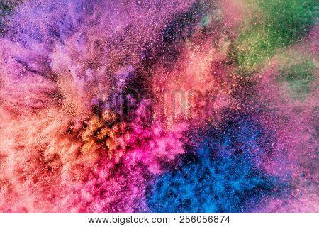 Colorful holi powder blowing up. Holi festival and celebration. Background.
