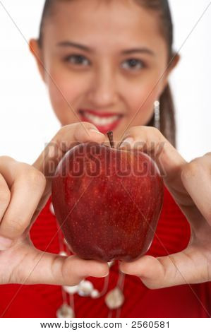 Young Girl Holding Apple