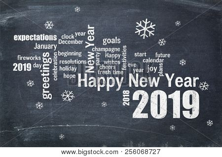 Happy New Year 2019 word cloud - white chalk text  on a blackboard, a greeting card