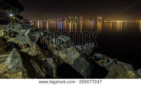 San Diego Skyline, Night, Water Reflections. San Diego Skyline At Night As Seen From Harbor Island.
