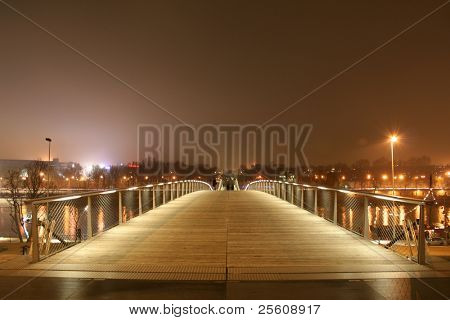 simon de beauvoir footbridge at night, paris, france